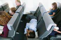 Man Sleeping on Airplane